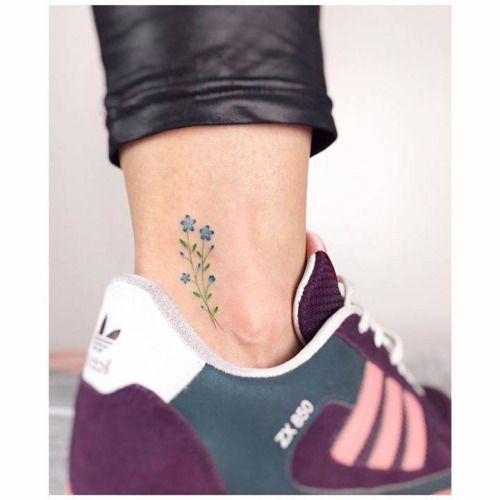 Little flowers on the ankle. Tattoo artist: Jakub Nowicz