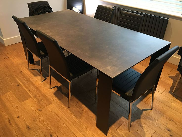 TAVOLE ceramic top fixed dining table. Ceramic top in Pizzara finish with matt black frame. Delivered to our client in Kent.
