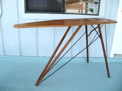 Interesting, expressed structure on this mid century modern ironing board.