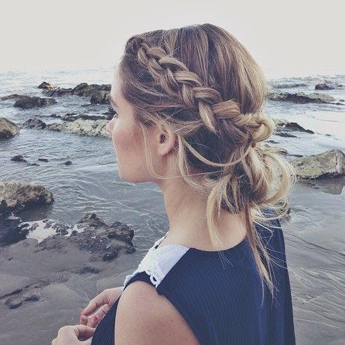 This adorably chic braided, messy bun is SO cute for a #wedding! #hairstyles