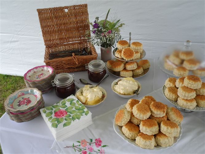 Scones, homemade jam and cream served as afternoon tea at a wedding