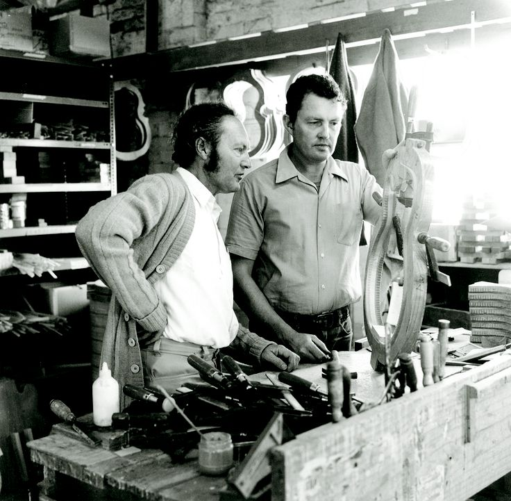 Bill May founder of Maton Guitars in 1946. At the workbench.
