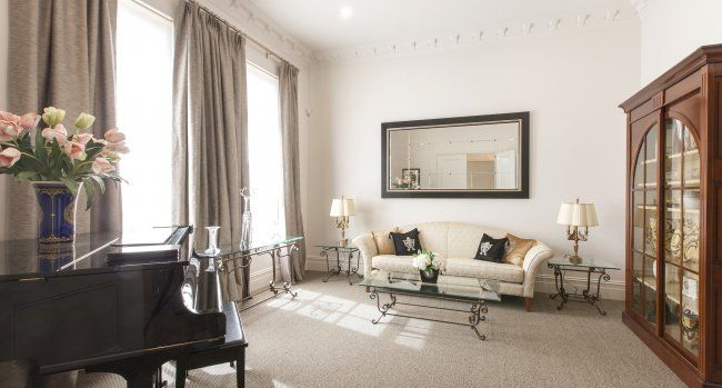 The front sitting room is cosy and inviting, with full height windows making the most of the natural light...