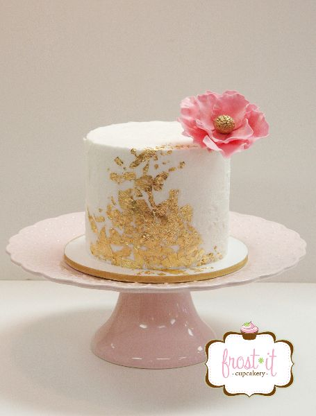 Rustic buttercream wedding cake with edible gold leaf.  Pink and gold wedding.  Cake: Frost It Cupcakery  #goldleaf #anniversarycake #pink