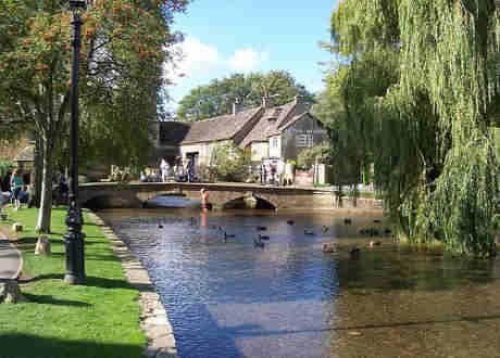 Bourton-on-the-Water in the Cotswolds.  The most chocolate box village in England, with its little bridges crossing the River Windrush, and little honey coloured stone cottages.  So pretty it's almost a cliche, but I love it.