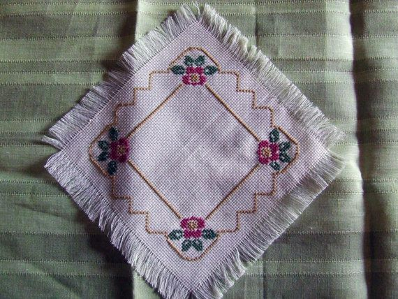 Pretty doily cross-stitch, small size (16 cm x 16 cm) made of very soft Aida.  Floral subjects.  One piece.