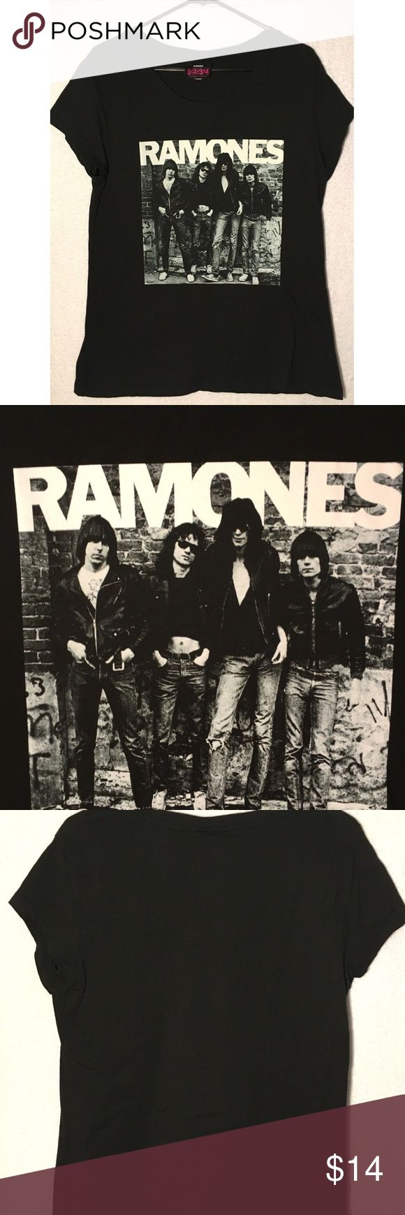 Ramones Womens T-Shirt Band Photo Cap Sleeve 2XL Nice authentic Ramones women's t-shirt Size 2XL Cap sleeves Black cotton. Features a nice band photo on front. Blank on back. Shipping includes tracking number. Please check measurements below to ensure proper fit. Thank you for viewing  MEASUREMENTS:  Armpit to armpit: 17  inches Length: 26  inches Ramones Tops Tees - Short Sleeve