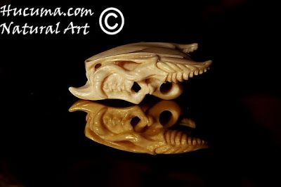 HUCUMA. artesanía en hueso y de diseño.: Colgante cráneo de Dragón