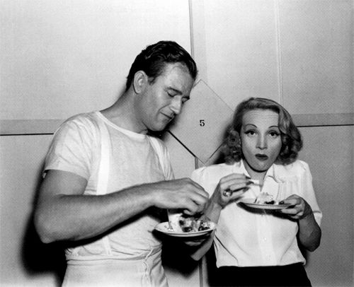 John Wayne and Marlene Dietrich on the set of Seven Sinners, 1940