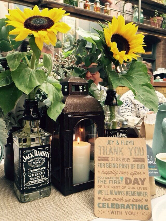Table setting for a breakfast wedding #sunflowers #rustic #jackdaniels