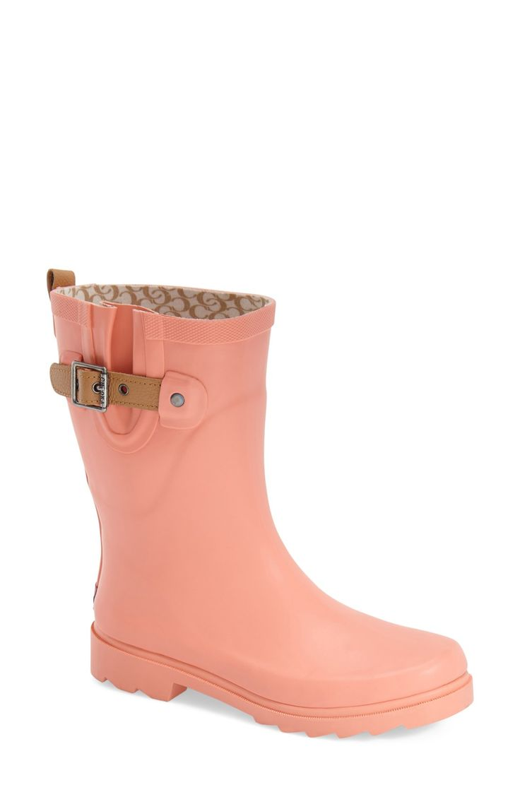 Absolutely loving these cute pink rain boots that are perfect for staying dry on drizzly days.
