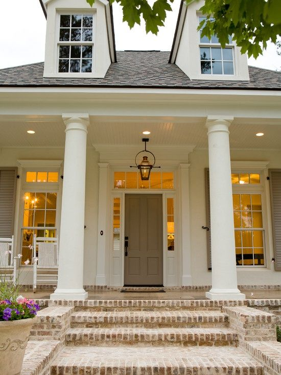 Such a pretty front porch/entry way! I love the color of the door and shutters.