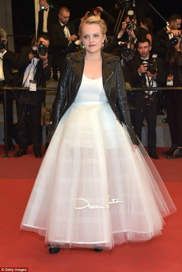 Vintage with an edge: Mad Men star Elisabeth Moss graced the red carpet in a billowing white Oscar de la Renta gown, which she paired with a leather biker jacket