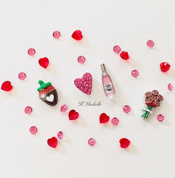 Pure cuteness from Origami Owls Valentine's Day charm collection! Love me some wine, chocolate strawberries, roses filled with ❤️❤️. #jewels #swarovskicrystals #lockets #charms #hearthstone #heartcharms #valentinesday #valentinesdaygiftideas