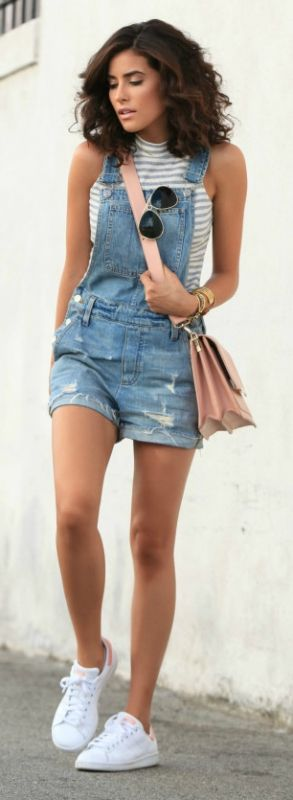 Dungarees go perfectly with a high necked striped tank top! Via Sazan Barzani  Top: Charlotte Russe, Dungarees: Madewell, Shoes: Adidas