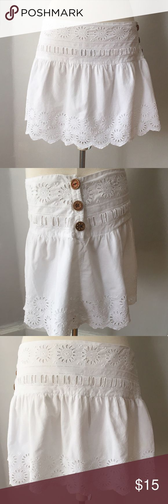 """American Eagle Outfitters  white eyelet skirt American Eagle Outfitter white eyelet skirt!!! Has pretty wooden buttons for side closure. Measurements flat are waist 16"""", hips are 19"""" at bottom of the band. Skirt length is 13"""". American Eagle Outfitters Skirts Mini"""