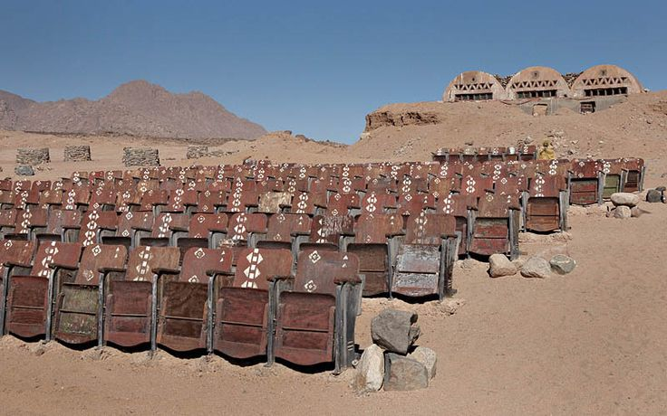 An abandoned outdoor movie theatre in the Sinai Desert. Somewhere on the southern tip of the Sinai Peninsula in Egypt, nestled at the foot of a desert mountain range, sits an odd sight that is almost completely out of place: hundreds of seats for an outdoor movie theater.