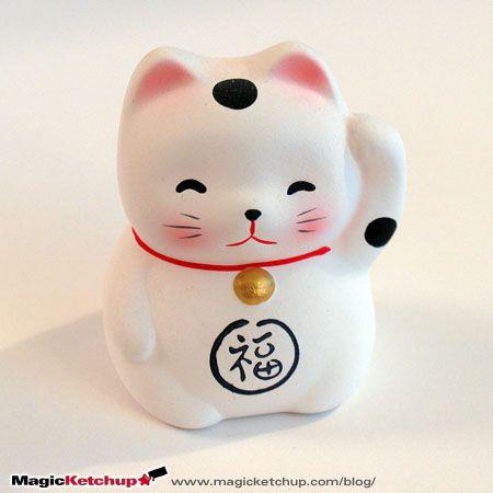 Maneki Neko - tradiční soška pro štěstí