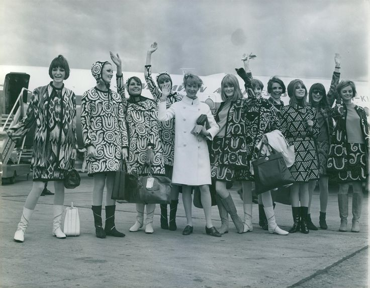 Katja of Sweden waving for the camera with her models at the airplane tarmac. 1966.
