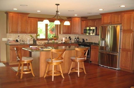 A picture from one of our customer's beautiful kitchen. Brazilian Cherry Hardwood Floor