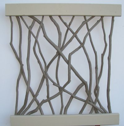 DIY Wall Art ~ Paint branches to color of choice and then hot glue ends onto the backs of 2 painted & parallel 1″x2″ boards.  Arrange branches loosely for a sculptural effect and hang on the wall.