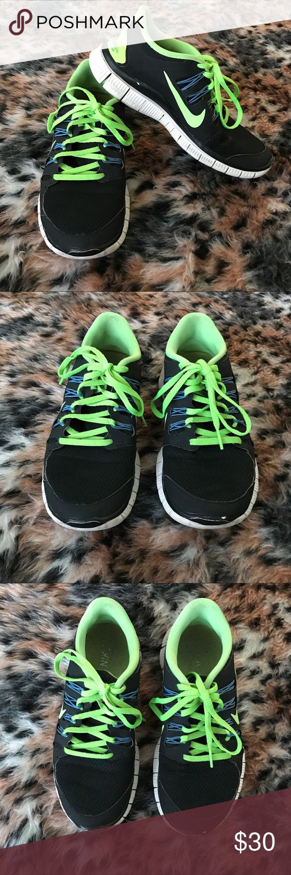 "Nike Free 5.0 black and lime green athletic shoes A gently used black and lime green pair of athletic shoes by Nike in a size 7.5 and in the style ""Nike Free Run 5.0"".  ✨ Ask me about free shipping! 💕 Always ships within 2 business day 🚫 I do not trade"