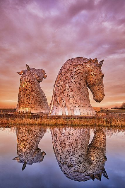 The Kelpies, a pair of stunning equine statues gracing the eastern entrance to the Forth & Clyde Canal, are named after mythical Scottish water-horses. The two 30m-tall horse's heads are fashioned out of stainless steel, and are a tribute to the working horses that once hauled barges along the canal. /www.lonelyplanet.com/united-kingdom/scotland/falkirk/sights/landmarks-monuments/the-kelpies#ixzz3E3szYY4o