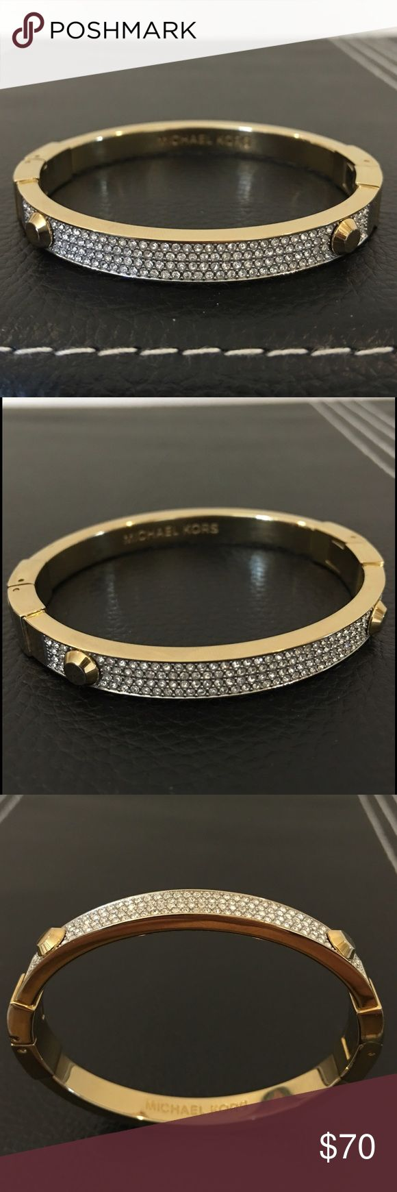 Authentic MICHAEL KORS bracelet Authentic MICHAEL KORS bracelet.  Pave crystals and studs embellish this sturdy gold tone bangle bracelet.  In excellent preowned condition.  Please ask any questions you may have before purchasing. 🚫Trades, 🚫Low ball offers please. Michael Kors Jewelry Bracelets