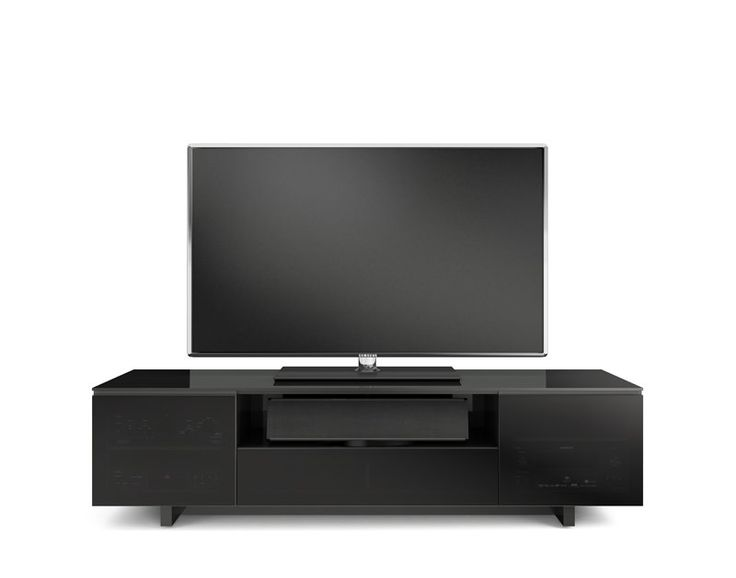 The modern design of the Nora Slim TV stand creates a sleek home for a flat panel TV and components. The TV stand is a standard depth for larger home theater systems, while the Nora Slim TV stand is perfect for systems with shallow components. Both models feature two adjustable side component compartments with soft-close doors. The center of the cabinets includes an open speaker/component compartment and a flip-down door that conceals two additional component compartments.
