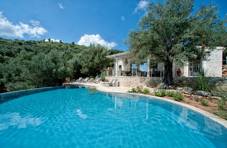 Mimosa House, Kalamaki, Perithia & Agios Ioannis - Sleeps up to 6. Nestled amid silvered olive groves on a peaceful coastal hillside, this excellent luxury villa boasts sea views from the exceptional swimming pool, and adds superb service to a secluded setting.