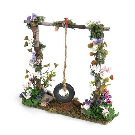 Swing....use a real swing and have climbing plants crawling up the chains.....
