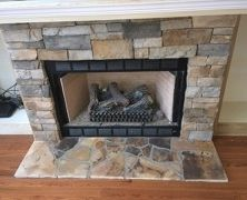 Manufactured stone fireplace brings cozy comfort and a central feature to this lakeside family room.