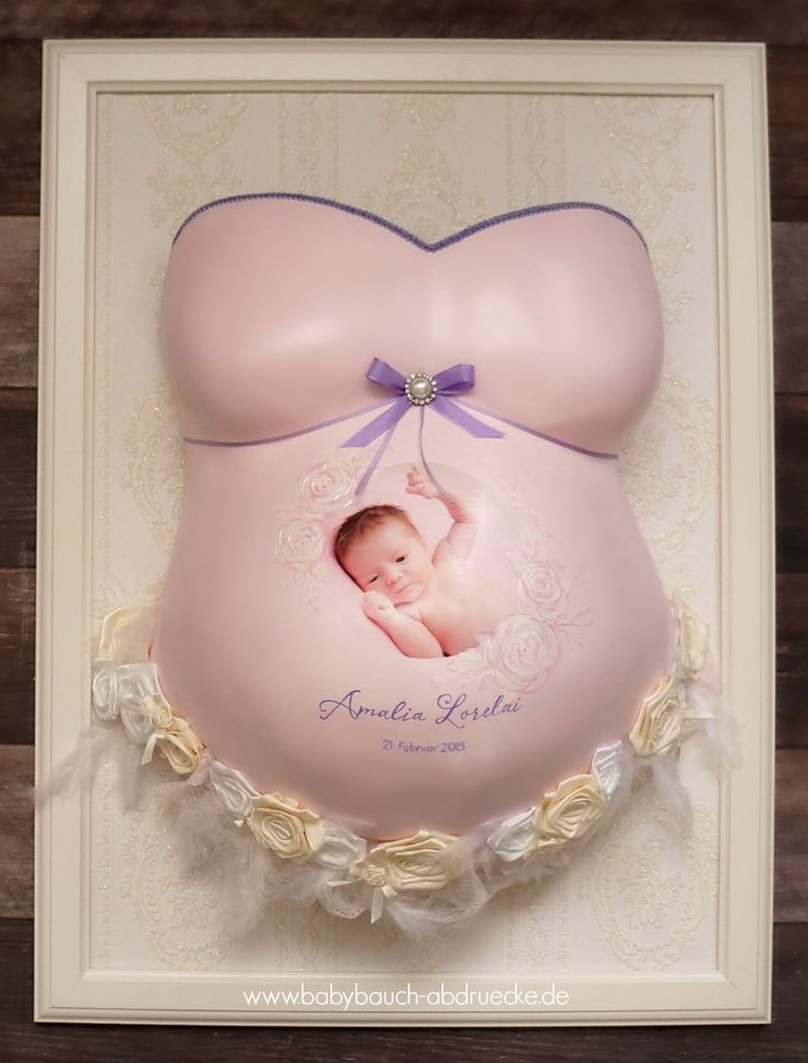 pregnancy belly cast - selfmade by customer.... We designed it in light pink with purple & baby photo on a frame.. www.babybauch-abdruecke.de