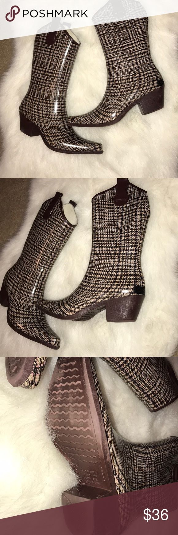 Plaid rain boots Plaid rain boots. Very gently used. Only flaw is on one Boot black label is chipped off. See photo Corkys Shoes Winter & Rain Boots