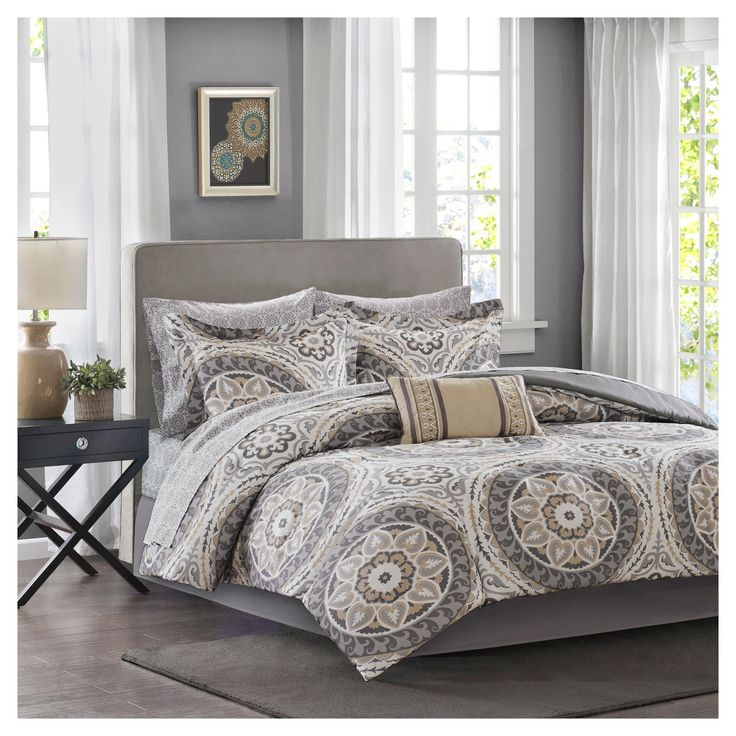 For a modern update to your space, the   Nepal Complete Bed and Sheet Set can provide a whole new look with warm colors. An intricate medallion pattern repeats across the top of bed with shades of taupe and grey playing up this oversized print. An oblong pillow uses decorative embroidery and piecing to create texture on the top of bed while 180 thread count cotton sheets feature a grey medallion print to complete this look.