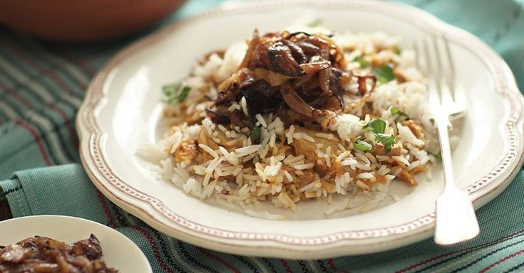 Biryani is a thing of beauty: spiced rice and succulent meats layered together and topped with a refreshing sauce.