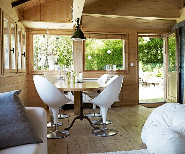 An old timber lakehouse is renovated to become a light, bright & spacious retreat.
