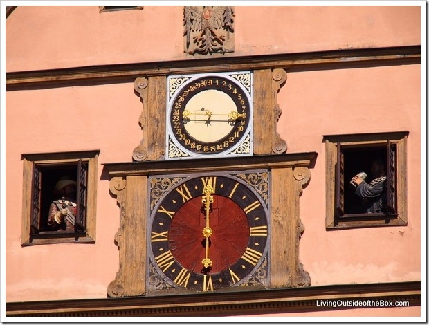 Clock strikes at 6 in Rothenburg, Germany