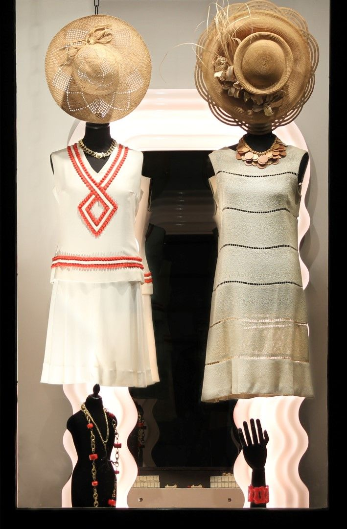 On the left wearing:1960s silk skirt and blouse with coral embroidery, 1970s Florentine straw hat, 1950s Coro necklace.  Outfit on the right:1960s iuta dress, 1920s Florentine straw hat, 1980s wooden necklace.  On the pedestal:1990s KJL coral-shaped necklace, 1990s necklace with red charms, 1990s KJL bakelite bracelet, 1990s KJL coral-shaped earrings, 1980s wooden earrings.