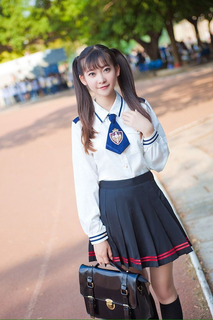Black and red striped japanese pleated uniform seifuku skirt via Shy Lolita. Click on the image to see more!
