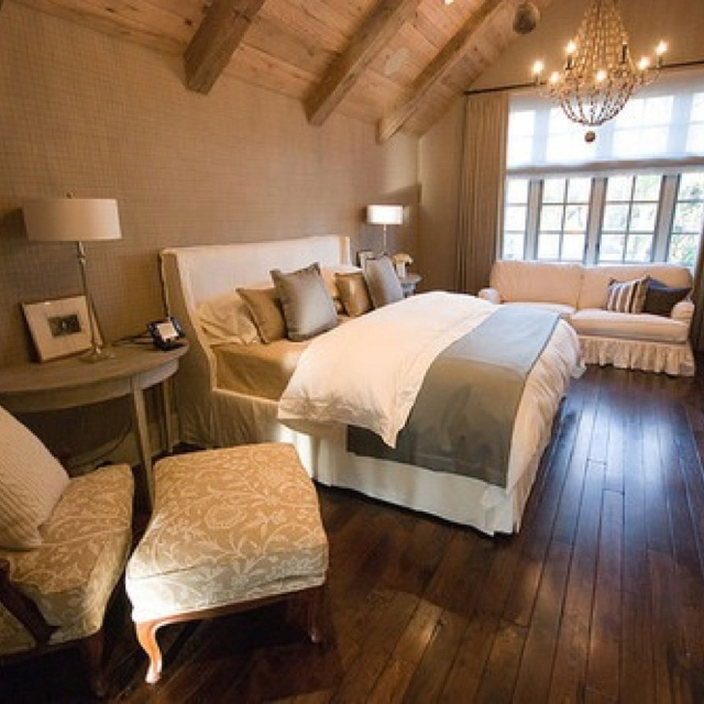 Attic room vaulted ceiling bedroom love the earthy color palate the chair and ottoman and the - Attic bedroom design ideas with wooden flooring ...