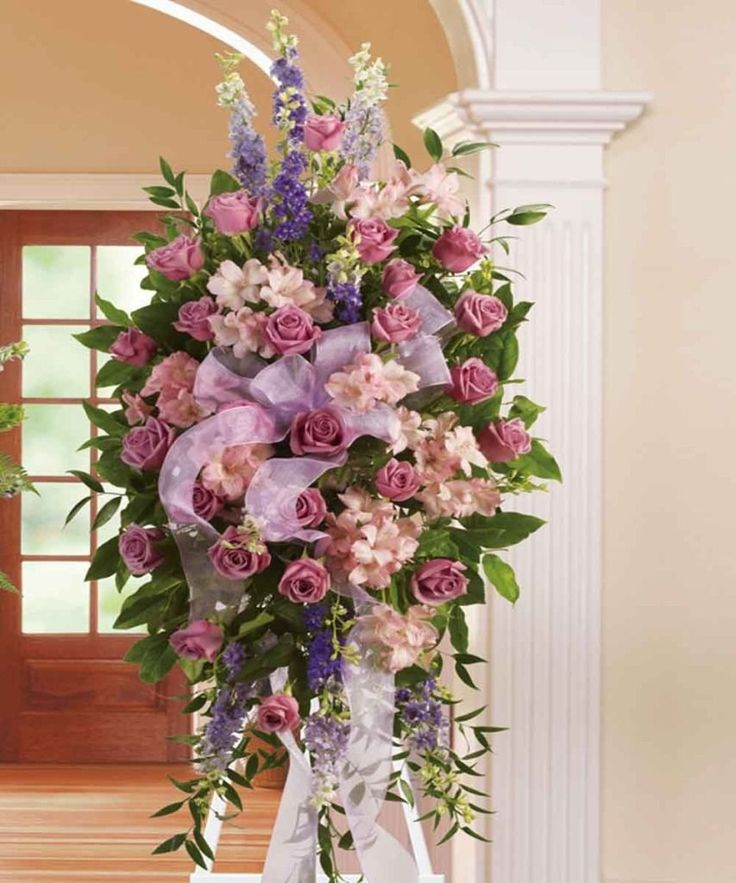 A Nice Spray With Roses Lilies And Other Flowers