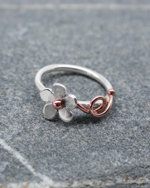 A charming daisy ring with a 10mm silver flower with a satin finish.  The ring has a copper centre bead with copper tendrils entwined around a silver wire band.  Also available with a brass bead and tendrils.  #copper #daisy #flower #handmade #ring #silver #starboardjewellery #jewellery #cornwall #uk #gb #westcountry #devon #england #silversmith #pretty #jeweller #jewellers #handmadejewellery #handmade