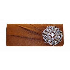 This chocolate #brown #clutch #bag is secure and has a lovely brooch for a touch of class - See more at: http://myeveningdress.co.uk/clutch-bags/1366-chocolate-brown-evening-bag-with-a-silver-brooch.html#sthash.sH5RMoST.dpuf