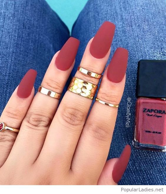 Matte red nails with gold rings