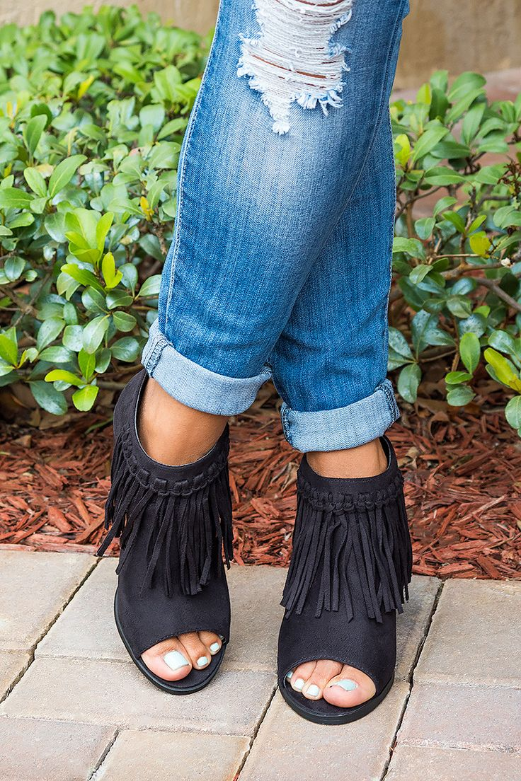 """Theses fringed booties pair perfectly with everything, for a trend-right appeal. Great with jeans and dress! Features: - Fringed detailing at front with open sides - Back zipper closure - 3"""" heel stac"""