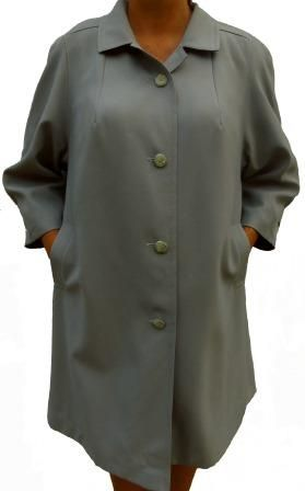 A loose European style all weather water resistant coat with three quarter sleeves, two pockets, padded rounded shoulders with no defined seams, full lining, stunning finishes and in excellent condition. An elegant summer light coat.