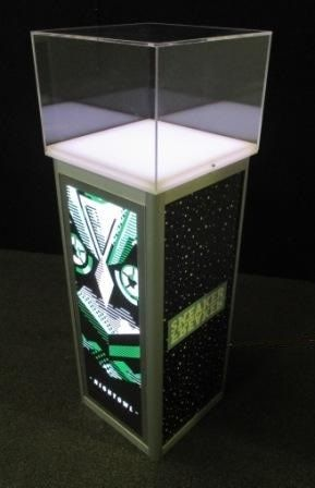 Lit pedestal base with glass case under lit to really show off the products.