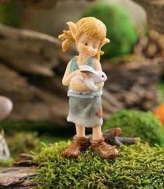 Garden pixie hugging a bunny