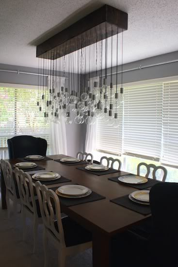 Cool way to use our existing light bulbs for a centerpiece over conference table - RL
